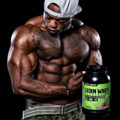man flexing holding tub of Lean Whey protein