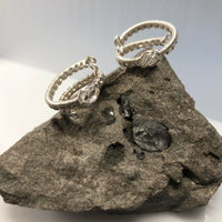 Argentium Silver Herkimer Diamond Wrap Rings. (Each purchase is for one ring. They are shown here to show the unique raw beauty each holds.). The rings are shown on Dolomite rock which contains Herkimer Diamonds.  The specimen is not included in the purchase of the ring.