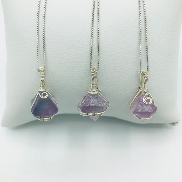 Three Argentium Silver Wire Wrapped Fluorite Octahedron Crystals on Rhodium Plated Sterling Silver Box Chains . (Left to right:. 1st is mini horizontal coil, 2nd is Large Horizontal Crystal, 3rd is Two Vertical Coils)