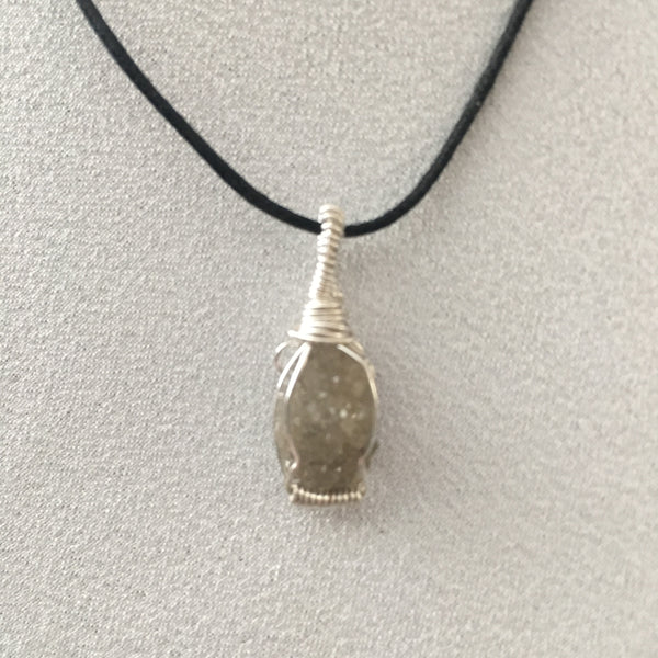 Naturally colored druzy wire wrapped necklace.