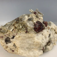 Garnet Wire Wrapped Ring displayed on a Garnet Rock Specimen  (Specimen Sold Separately)