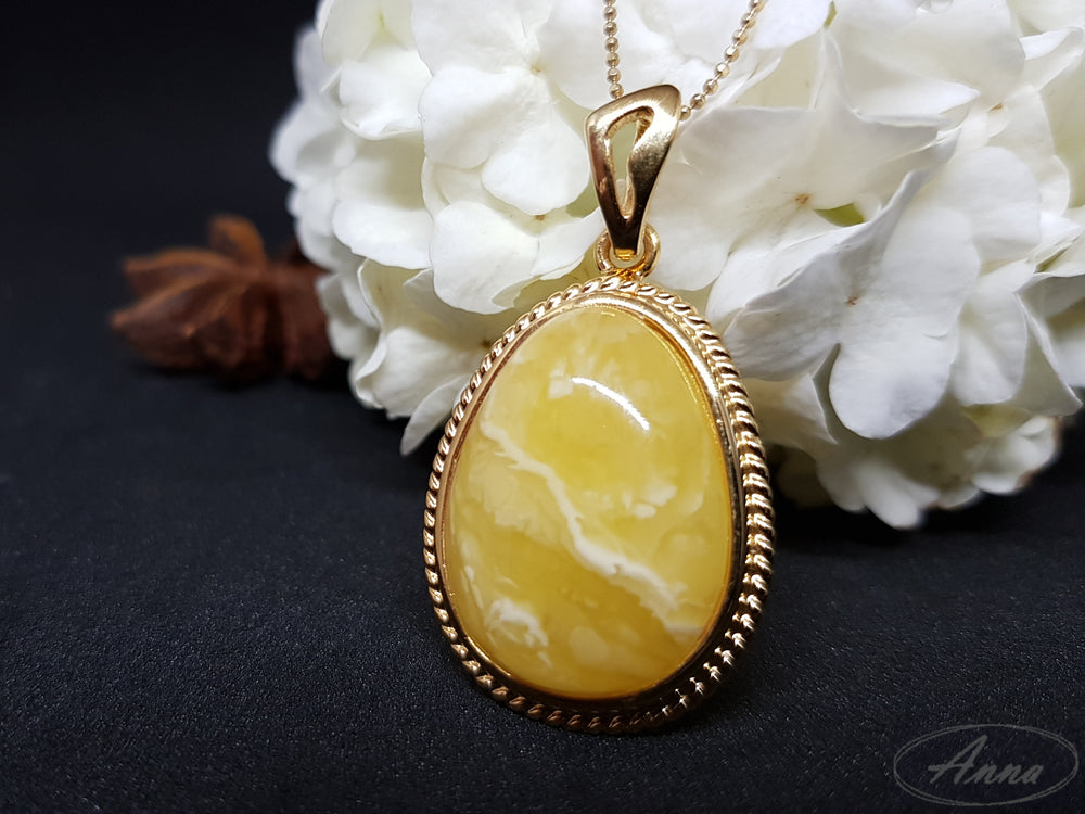 Unique yellow Amber pendant with white reflexes