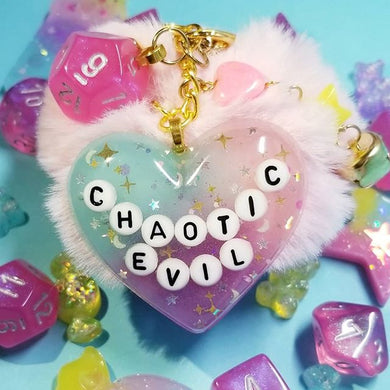 Chaotic Evil D&D Pink Puff Keychain with Die