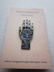 Enamel pin brooch, tattoo hand design, black and gold metal