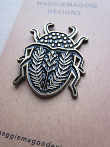 Enamel pin brooch, beetle design, black and gold metal