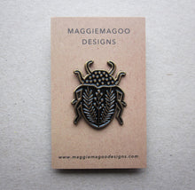 Load image into Gallery viewer, Enamel pin brooch, beetle design, black and gold metal