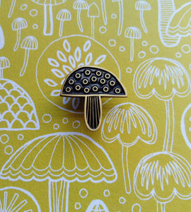 Toadstool and mushroom enamel pin brooch, black and gold metal