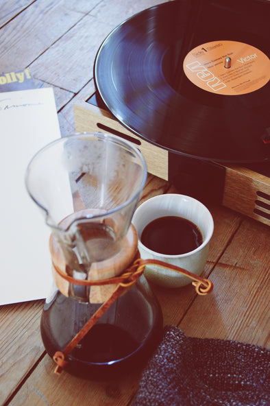 Chemex with a record and coffee cup