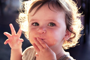 blog watch me bloom, recipes for growing me ~9 months, how to make finger foods, close up of baby boy with mouth full and fingers spread out