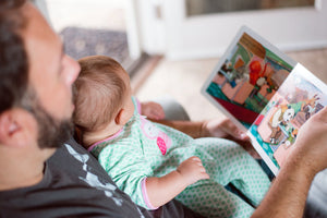 blog watch me bloom, recipes for growing me ~6 months, when to start reading to your baby, close up of dad reading to baby