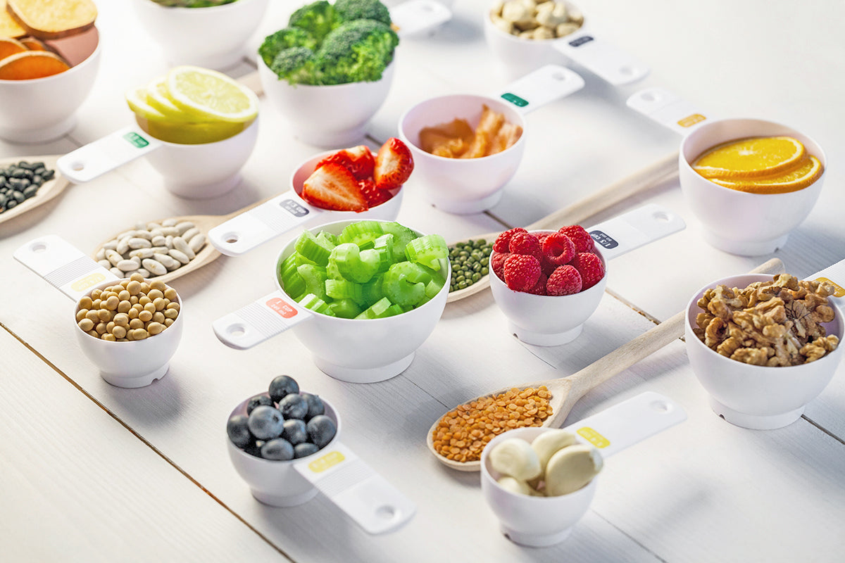 Individual food portion sizes in measuring cups for feeding baby