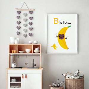 "Bouncing ""B is for Banana"" yellow character brown happy face with banana peel illustration on white background, DIY printable"