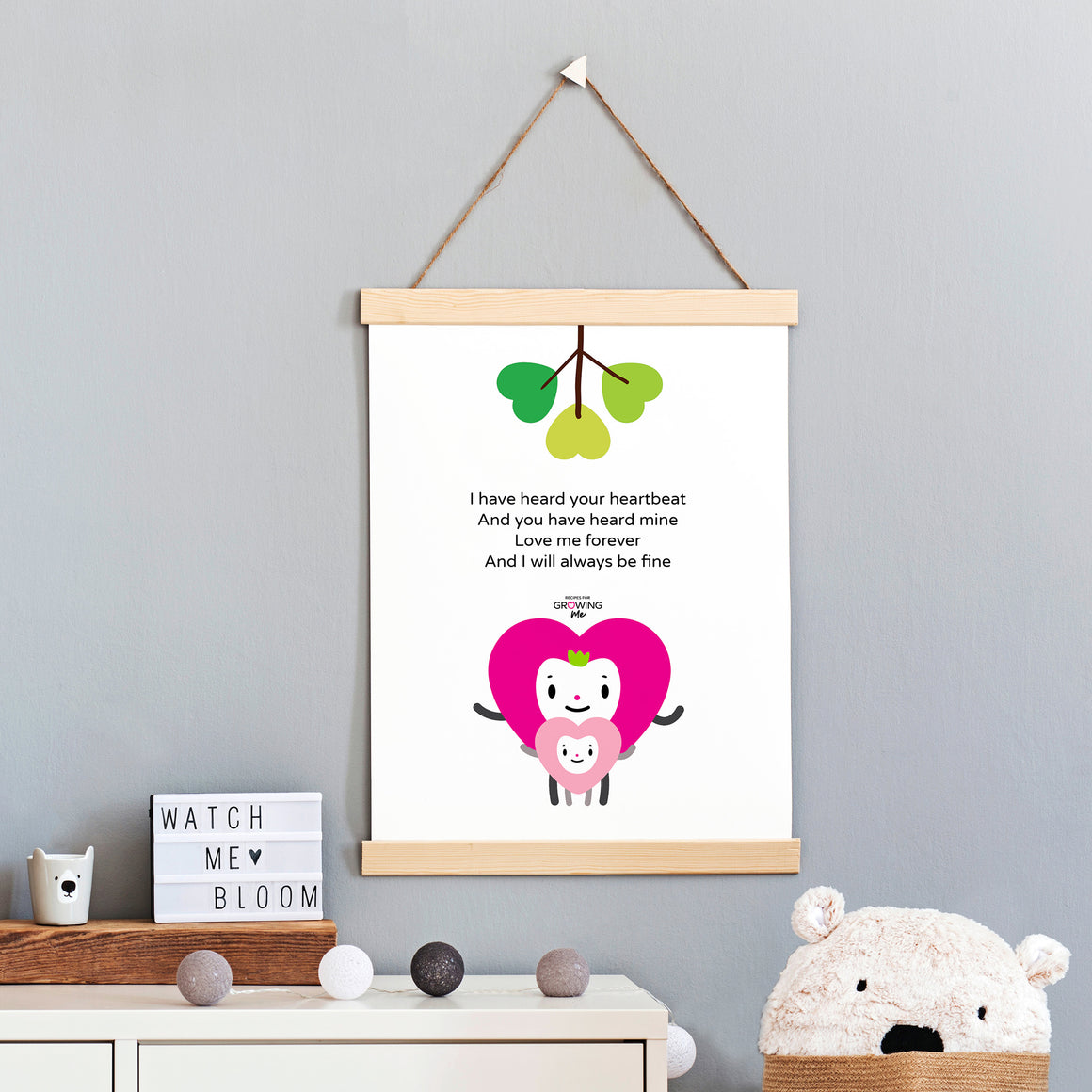Rhyming baby poem, fuchsia and pink mom and baby hearts together with green heart tree character illustration on white background, black lettering, shown in a sample hanging wood and string frame on wall of baby's room, free digital download DIY printable