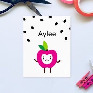 Download and print your own personalized adorable fuchsia apple happy face character with black apple seeds graphic background illustration, shown on 8.5x11 white paper