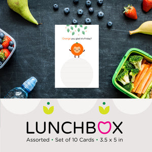 sample lunchbox card orange happy face character illustration on white background with green leaves and space to write your own message, shown on sample background with surrounding fruits