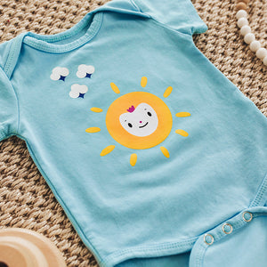 soft blue coloured short sleeve onesie cotton and spandex blend, imprinted with a bright yellow sun happy face character illustration and 3 small white puff clouds, 3 snaps at bottom, new baby shower gift