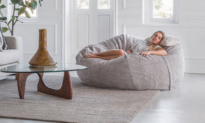 woman chilling comfortably on a fatsak beanbag