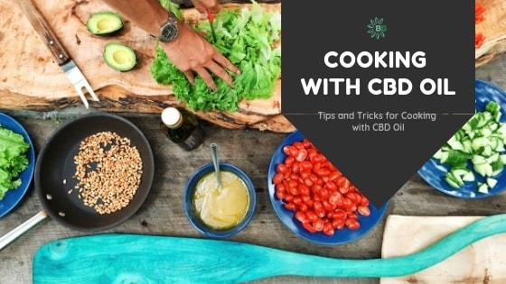 Lettuce being cut on a wooden cutting board with bowls of vegetables, dressing and seeds around it. Text in right hand corner: Cooking with CBD Oil - Tips and Tricks for Cooking with CBD Oil -