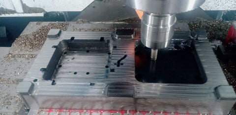 Case mould being milled on a CNC machine