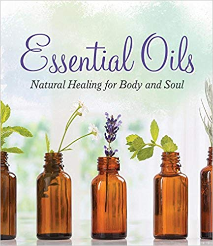 ESSENTIAL OILS: NATURAL HEALING FOR BODY AND SOUL  by the Editors of Publications International, Ltd.