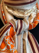 Load image into Gallery viewer, Satin scarf with chain pattern in orange/cream - chichappensboutique