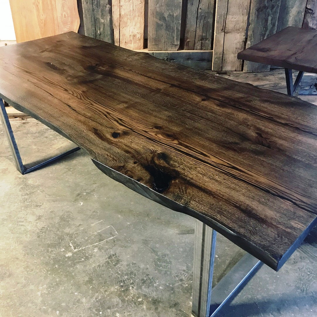 Reclaimed ebony stained live edge oak dining table