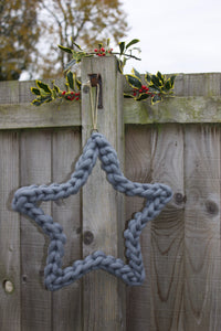 Felted Wool Hanging Star, as seen in CountryLiving.com