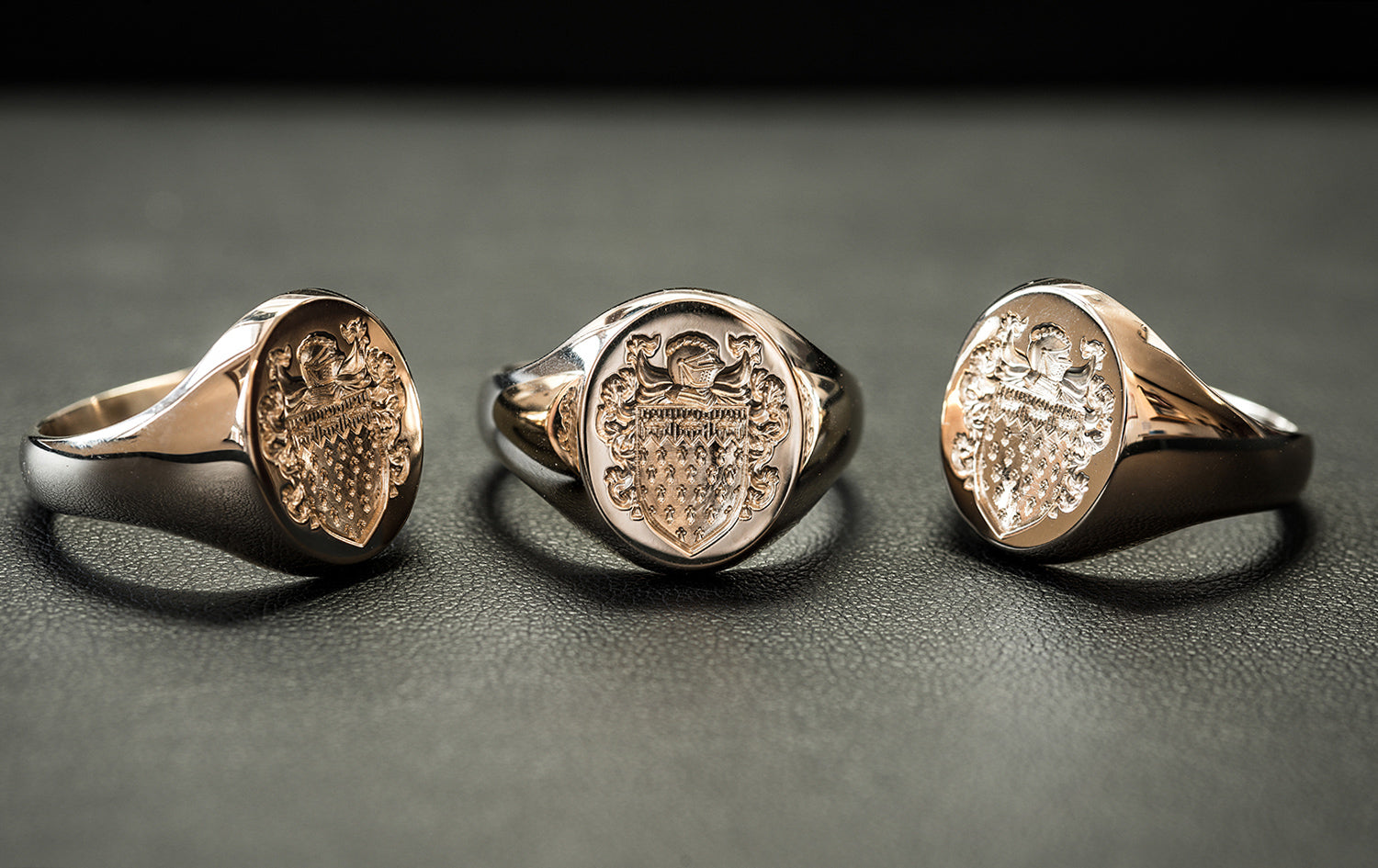 3 bespoke signet rings with deep seal engraving of a family crest