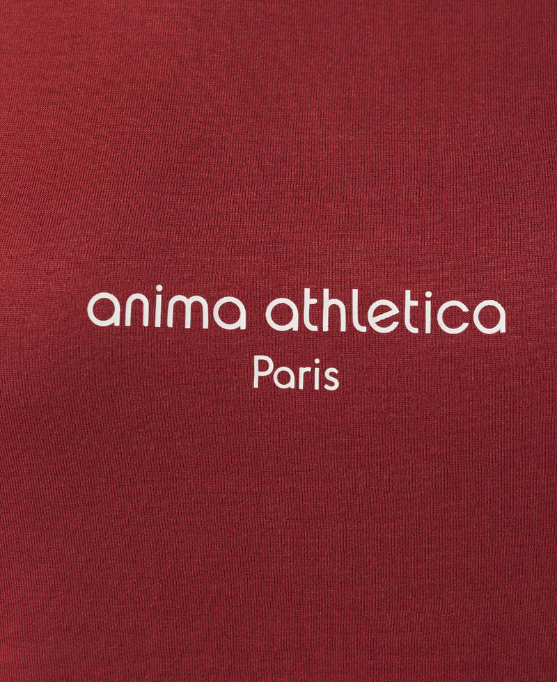 Inscription Anima Athletica Paris sur l'avant du débardeur de yoga pour femme active