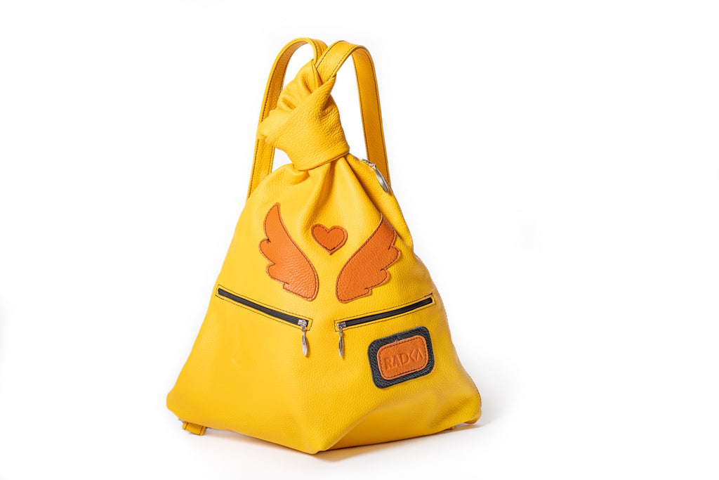 yellow bag with orange wings and hearth charismatic archangel backpack