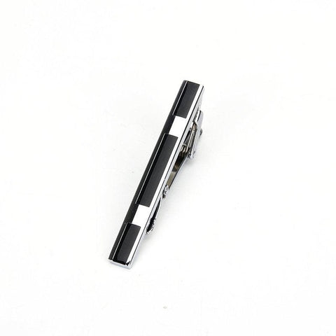 Polished black and silver tie clip with sharp detail
