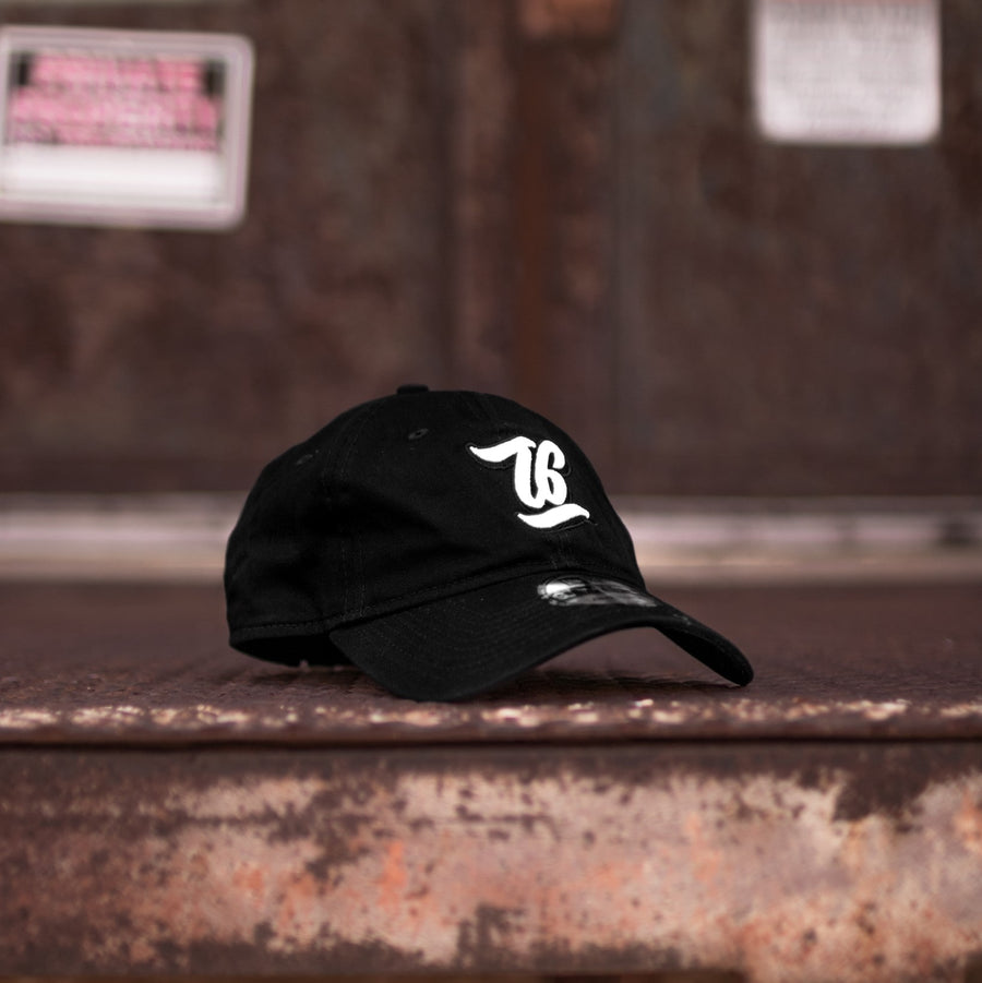 t6 designs new era dad hat baseball cap black script design brand.