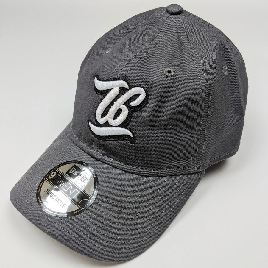 T6 Cursive - T6 Designs grey New Era  adjustable unstructured caps were our pick for this amazing hat you see here! Normal raised embroidery with T6 (in cursive) centered in the middle of the cap.