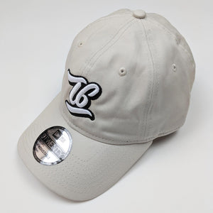 T6 Cursive - T6 Designs Wheat New Era  adjustable unstructured caps were our pick for this amazing hat you see here! Normal raised embroidery with T6 (in cursive) centered in the middle of the cap.