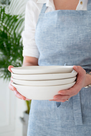 These Clay Serving Plates are a part of the Artisan Pottery Collection, created by Burgeon ceramics for White & Faded. Made with natural clay, that white satin glaze on top renders an aesthetic finish to these gorgeous plates. The muted white shade makes it a statement piece in your collection of serveware.