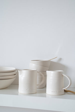 An integral part of the Artisan Collection, the Milk Jug from the house of White & Faded is a subtle and minimalist addition to your collection of crockeries. These statement jars come with a convenient handle, along with the White & Faded logo embossed into its ceramic body.