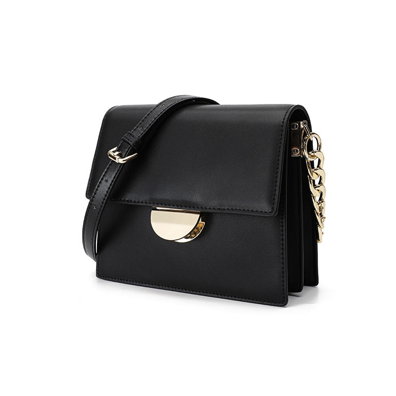 Classic Black Leather Bag with Gold Chain Detail - Sarah Urban