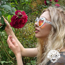 Load image into Gallery viewer, Heart Shaped Kaleidoscope Glasses with Red Frames and Rainbow Tinted lenses, by GloFX.
