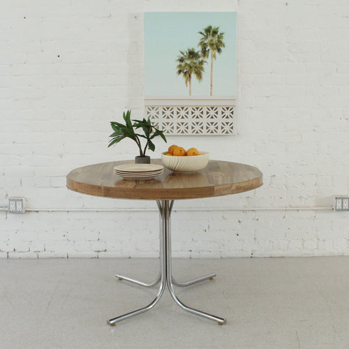 Faux Wood Round Dining Table with Chrome Legs
