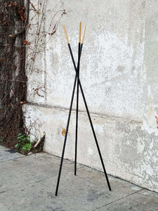 Sleek Blonde and Black Coat Rack