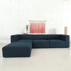 Sinclair Sectional with Ottoman in Dark Blue