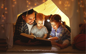 Dad with son and daughter reading kids books