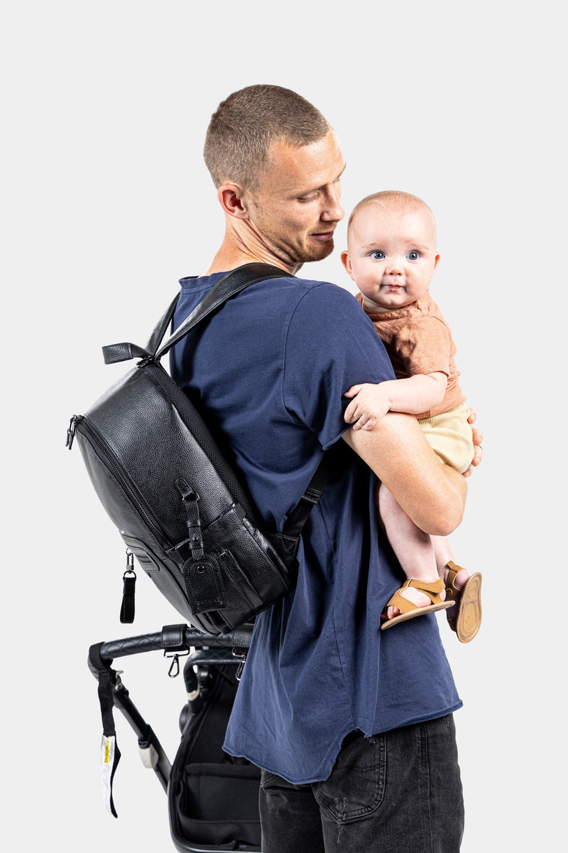 Dad with baby bag holding baby