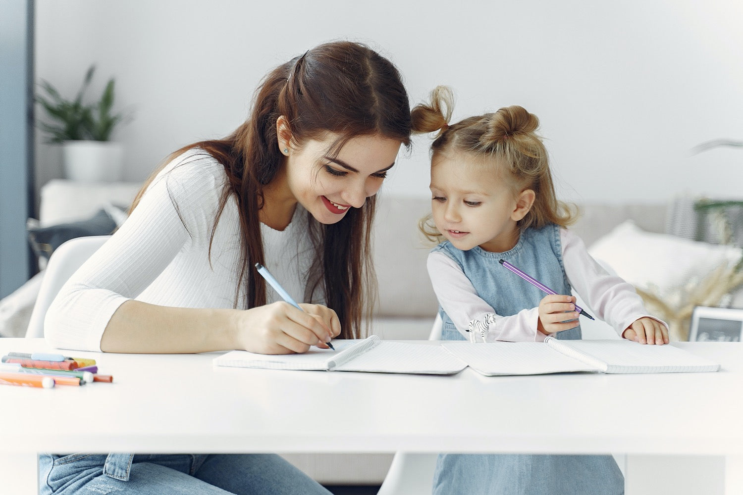 Mum and child studying together at home