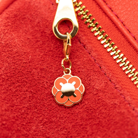 Geo - Jan19 - Tiny Orange Flower Charm