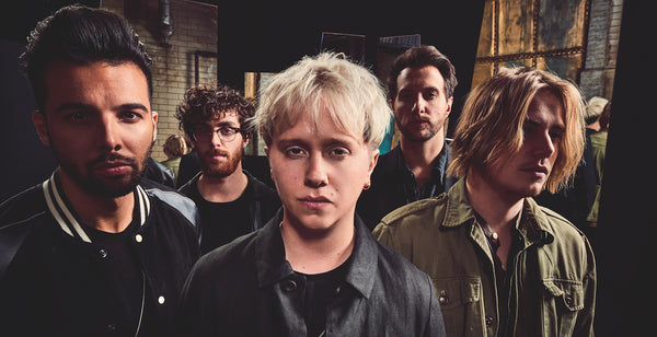 nothing but thieves|nothing but thieves mens mod style street fashion|nothing but thieves on stage mens street style|nothing but thieves sold out brixton academy mens street style|conor mason striped t-shirt black jeans black converse