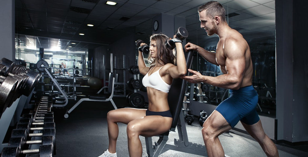 couple-working-out-in-the-gym|couple-exercises-plank-in-the-gym|couple-squat-workout-in-the-gym