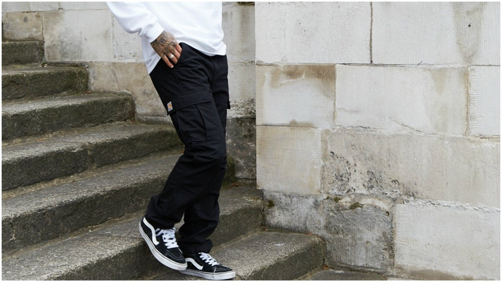 |vans sk8 high black trousers white jumper mens style|mens skate style camo shorts vans white tshirt|mens skate style white tshirt denim overshirt|mens skate style white trousers carhartt jacket black vans|mens skate style carhartt jacket black hoodie
