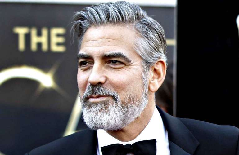 George Clooney with beard in suit