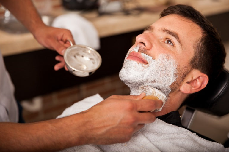 Man having wet shave in barbers